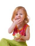 Muchacha con los pasteles aislados en blanco Imagen de archivo