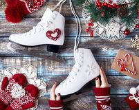 Muchacha con los patines de hielo Fotografía de archivo
