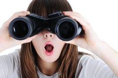 Muchacha con los prismáticos Fotografía de archivo