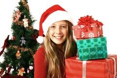 Muchacha con los regalos de la Navidad Fotografía de archivo