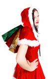 Muchacha con los regalos de Navidad aislados Imagen de archivo