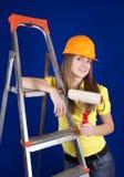 Muchacha con los rodillos de pintura Imagen de archivo libre de regalías