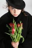 Muchacha con los tulipanes Foto de archivo libre de regalías