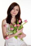 Muchacha con los tulipanes Fotografía de archivo libre de regalías