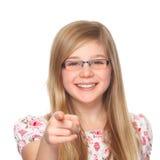 Muchacha con los vidrios que señala con el dedo índice Imagen de archivo libre de regalías