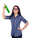 Muchacha con los vidrios que sostienen el lápiz verde gigante Imagen de archivo libre de regalías