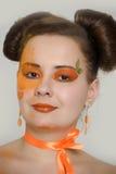 Muchacha con maquillaje anaranjado Imágenes de archivo libres de regalías