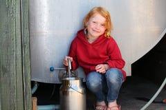 Muchacha con milkcan Imagen de archivo libre de regalías
