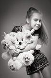 Muchacha con muchos juguetes fotos de archivo