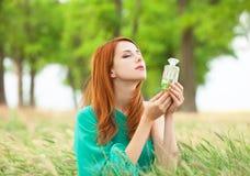 Muchacha con perfume Foto de archivo