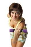 Muchacha con pesas de gimnasia Fotografía de archivo libre de regalías