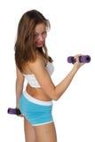 Muchacha con pesas de gimnasia Fotos de archivo libres de regalías