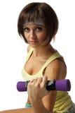 Muchacha con pesas de gimnasia Imagen de archivo libre de regalías