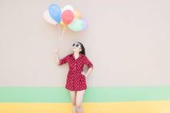 Muchacha con serie colorida de los globos Fotografía de archivo
