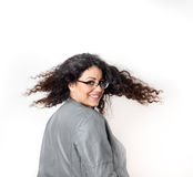 Muchacha con soplar el pelo rizado largo Fotografía de archivo libre de regalías