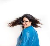 Muchacha con soplar el pelo rizado largo Fotos de archivo libres de regalías