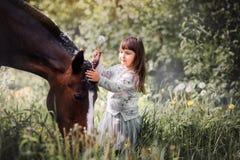 Muchacha con su amigo Foto de archivo libre de regalías