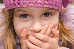 Muchacha con su boca cerrada Imágenes de archivo libres de regalías