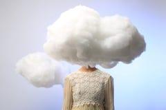 Muchacha con su cabeza en las nubes Imágenes de archivo libres de regalías