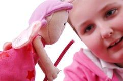 Muchacha con su muñeca Imágenes de archivo libres de regalías