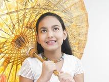 Muchacha con su paraguas del este Foto de archivo libre de regalías