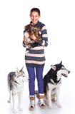 Muchacha con sus perros Fotos de archivo libres de regalías