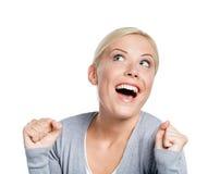 Señora feliz con sus puños para arriba Fotografía de archivo
