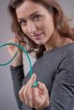 Muchacha con un alambre Foto de archivo libre de regalías