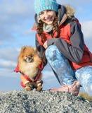 Muchacha con un animal doméstico Fotografía de archivo libre de regalías