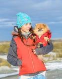 Muchacha con un animal doméstico Imágenes de archivo libres de regalías