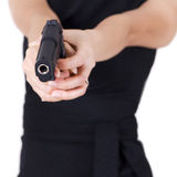 Muchacha con un arma. imagenes de archivo