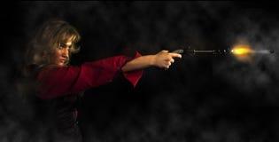 Muchacha con un arma Fotos de archivo