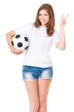 Muchacha con un balón de fútbol Fotografía de archivo