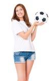 Muchacha con un balón de fútbol Imagenes de archivo