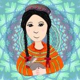 Muchacha con un conejo en un traje tradicional Ropa nacional tayica Imagen de archivo libre de regalías