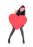 Muchacha con un corazón imagen de archivo libre de regalías