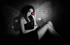 Muchacha con un corazón quebrado Imagen de archivo