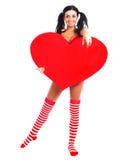 Muchacha con un corazón Fotografía de archivo