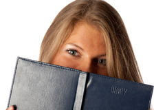 Muchacha con un diario Fotos de archivo