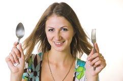 muchacha con un enchufe y la cuchara Imágenes de archivo libres de regalías
