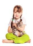 Muchacha con un gato Fotografía de archivo
