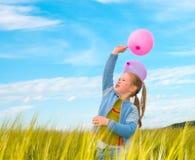 Muchacha con un globo Foto de archivo libre de regalías