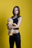 Muchacha con un juguete - mono Foto de archivo libre de regalías