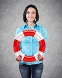 Muchacha con un lifebuoy Foto de archivo libre de regalías