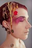 Muchacha con un maquillaje exótico brillante Imagenes de archivo