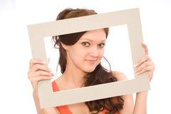 Muchacha con un marco Imagen de archivo