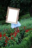 Muchacha con un marco de la foto Foto de archivo libre de regalías