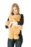 Muchacha con un oso del peluche Imagen de archivo libre de regalías