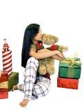 Muchacha con un oso y los regalos Imagen de archivo