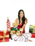Muchacha con un oso y los regalos Imagen de archivo libre de regalías